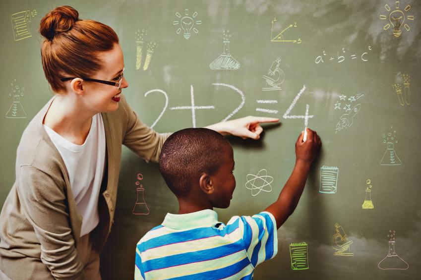 Teacher helping student with a math problem