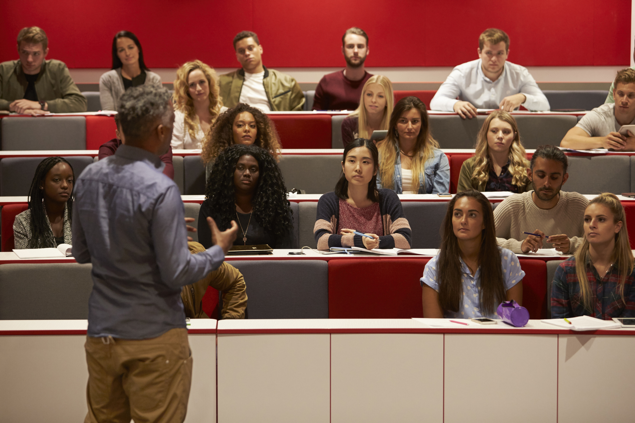 Professor lectures to postsecondary education students
