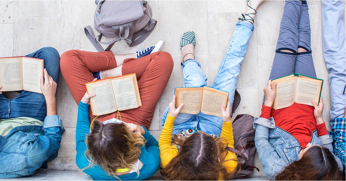 Adolescents enjoying reading books
