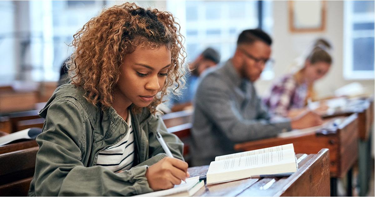 An ESL student working on her grammar lesson