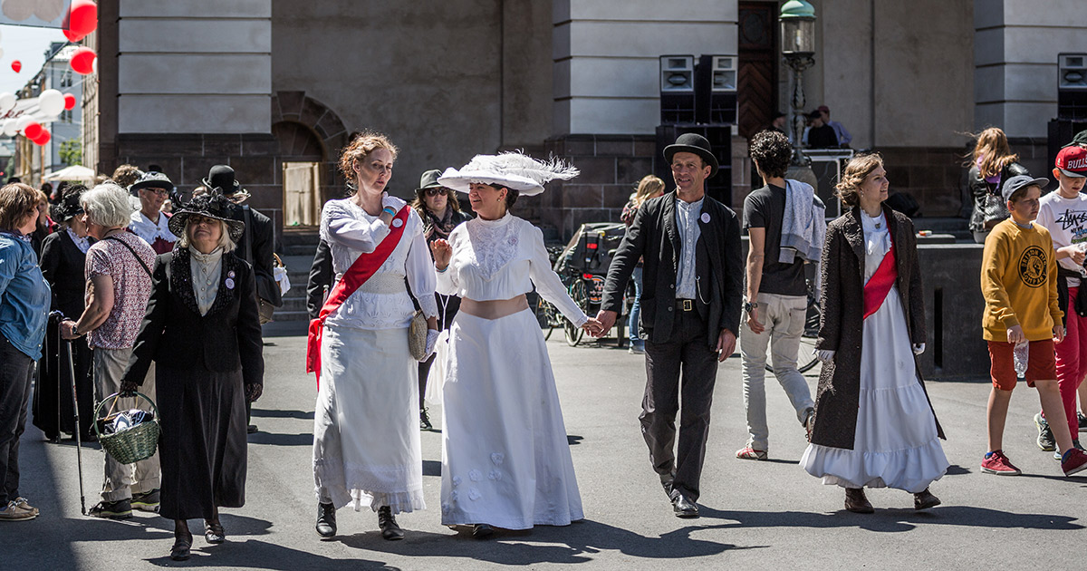 Women dressed as suffragettes