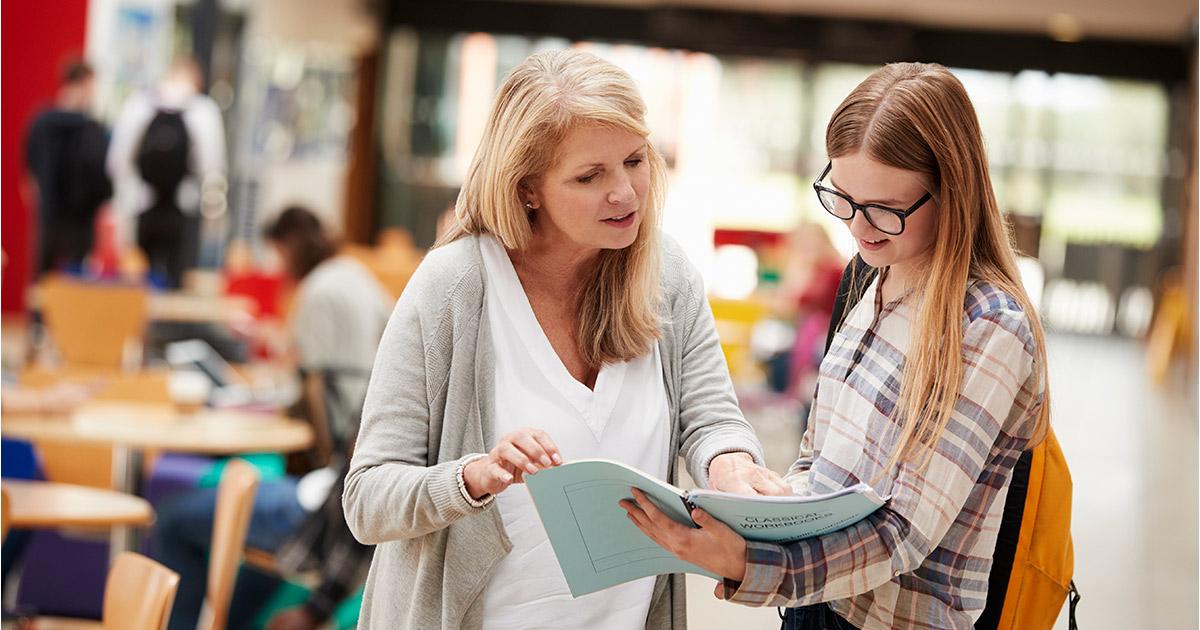 A teacher providing feedback to her student