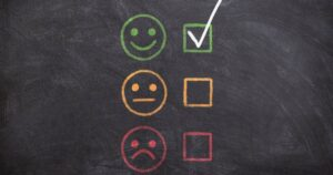 Happy faces on chalkboard