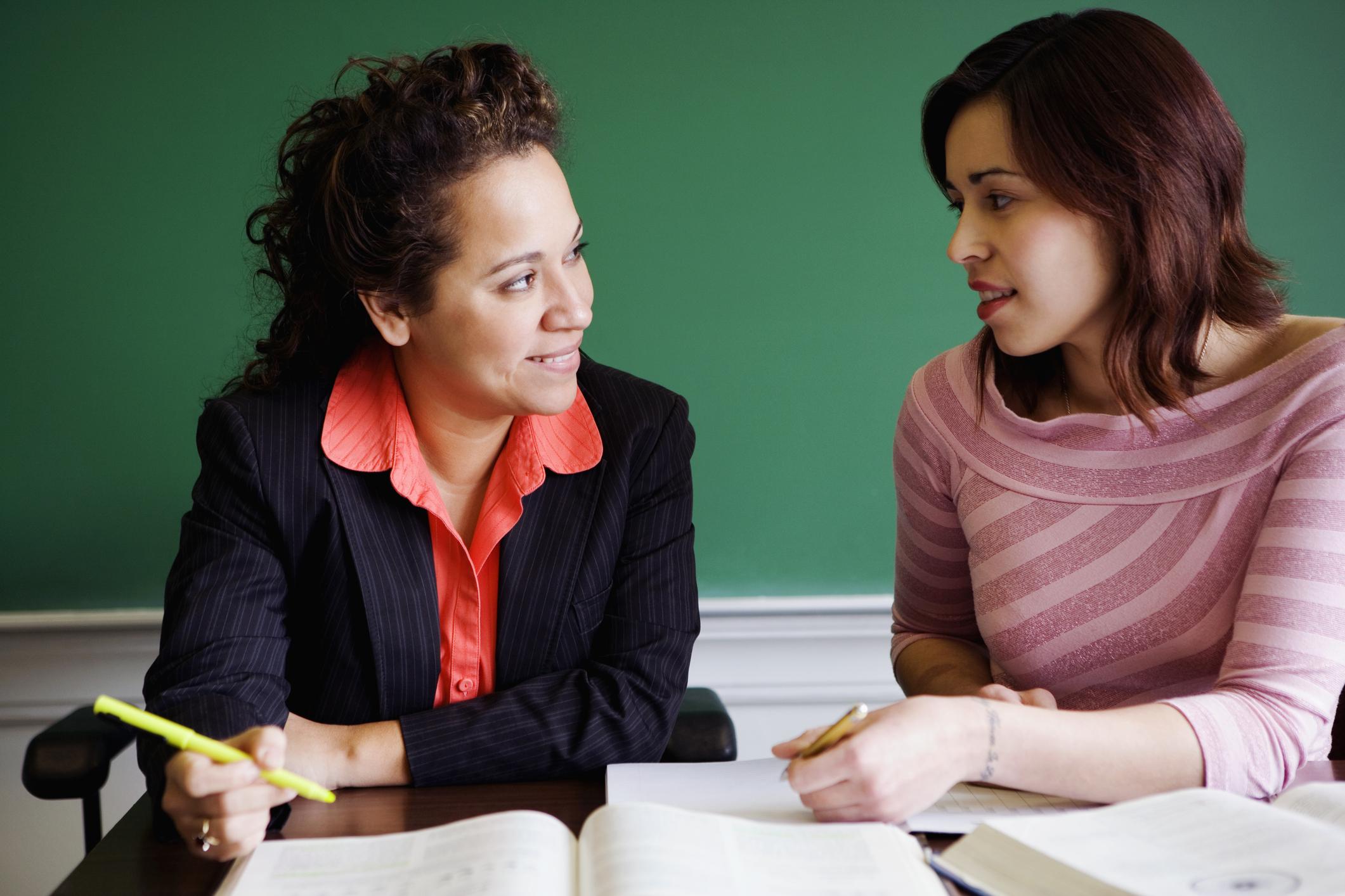 Teacher teaching student in Latin class