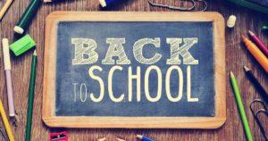 Back to school words written on a chalkboard