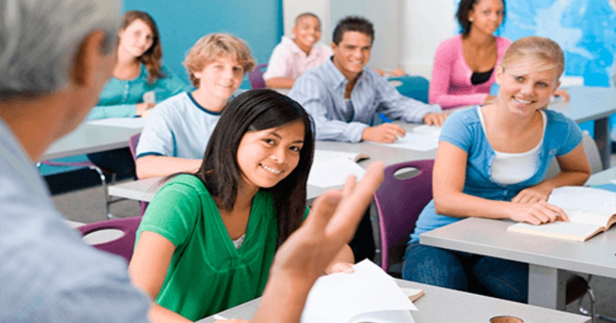 male teacher and teenagers in classroom
