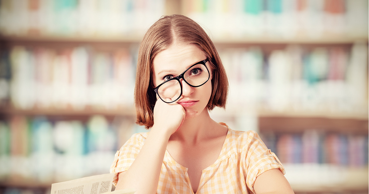 A frazzled teacher with glasses askew