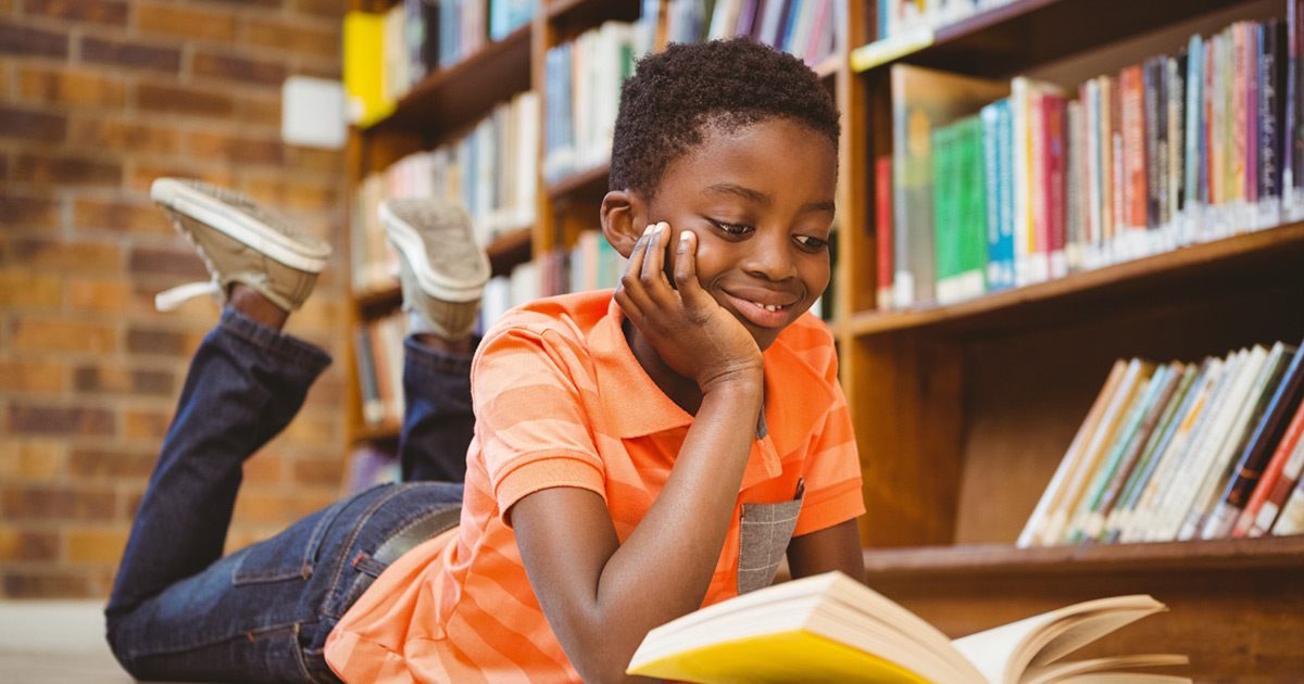 A student happily reading a book