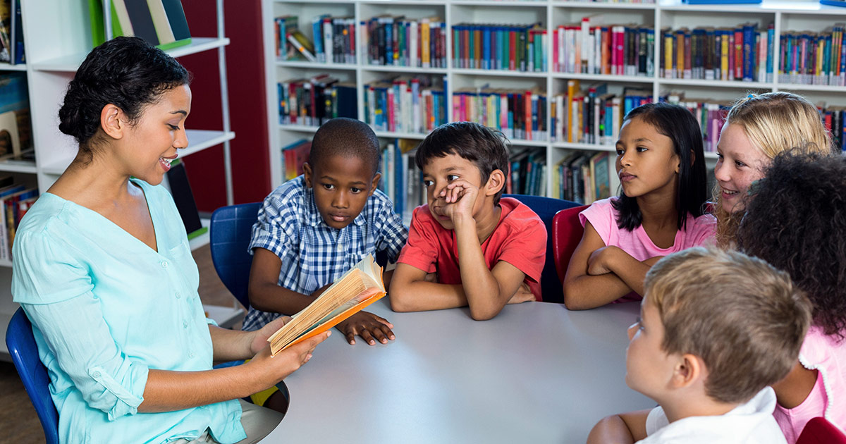 A teacher reading a story to her students