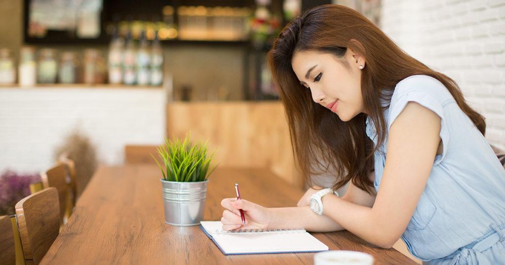 A teacher journaling