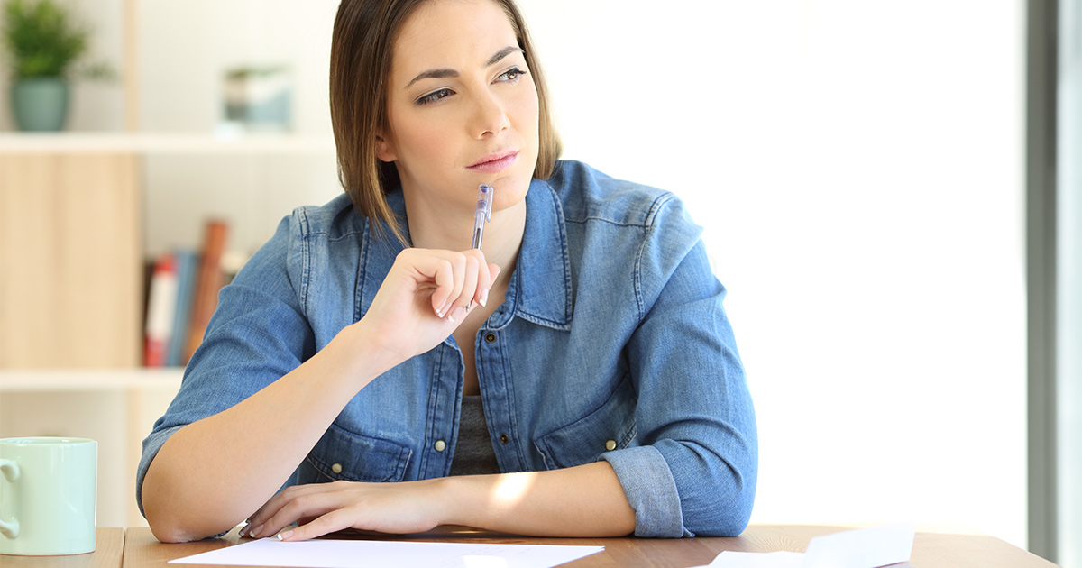 A teacher working on her actions and outcomes list