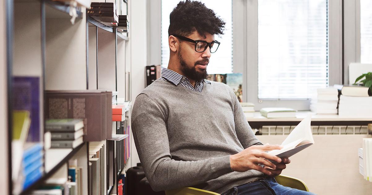 A teacher reading a self-improvement book