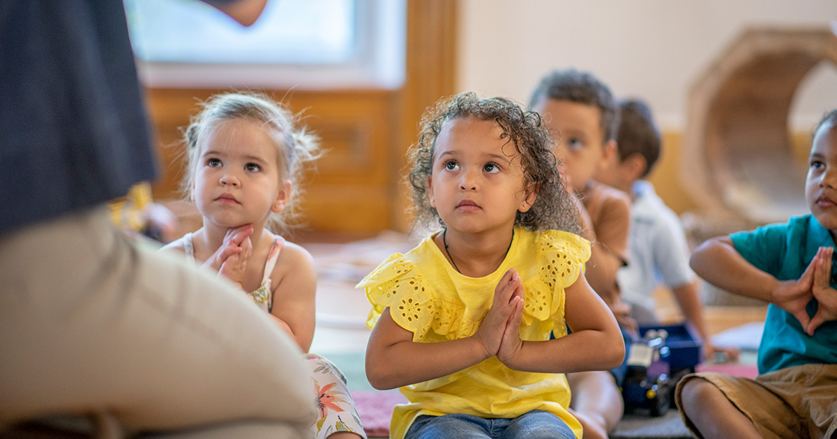 A teacher leading students in a mindfulness training