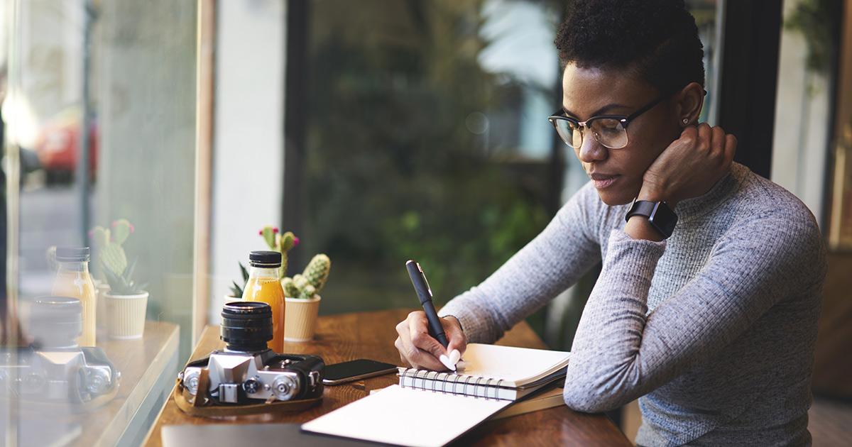 A teacher writing down her professional goals