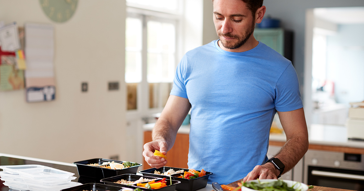 Guy cooking in kitchen