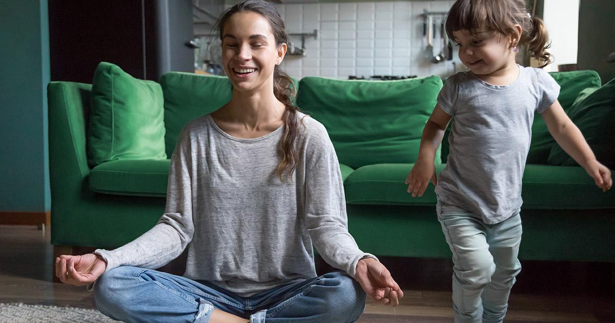 Lady meditating with kid