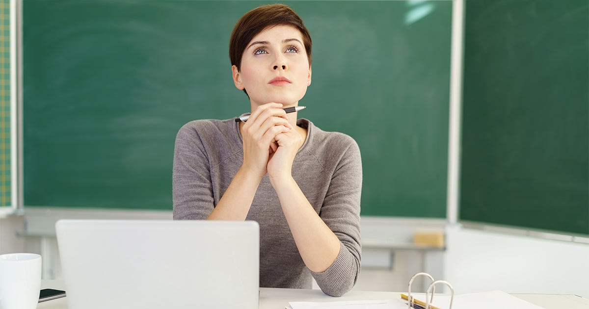 Woman staring at the top with laptop