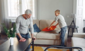 Man and boy cleaning