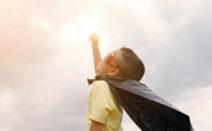 Boy pretending to be superhero