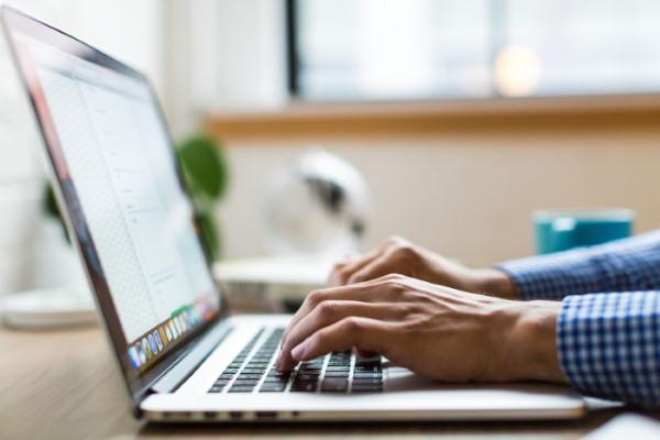 Man typing on laptop
