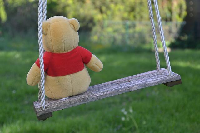 Stuffed animal on a swing set