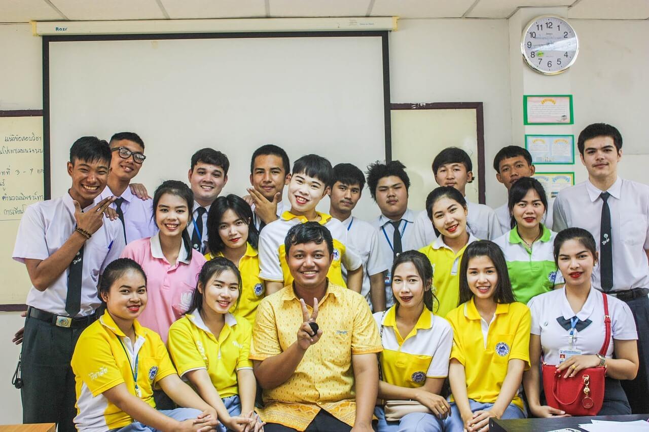 Happy kids in the classroom celebrating teacher