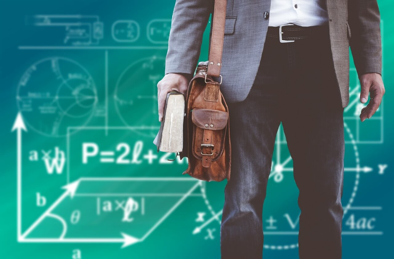 Student or professor with math chalkboard behind