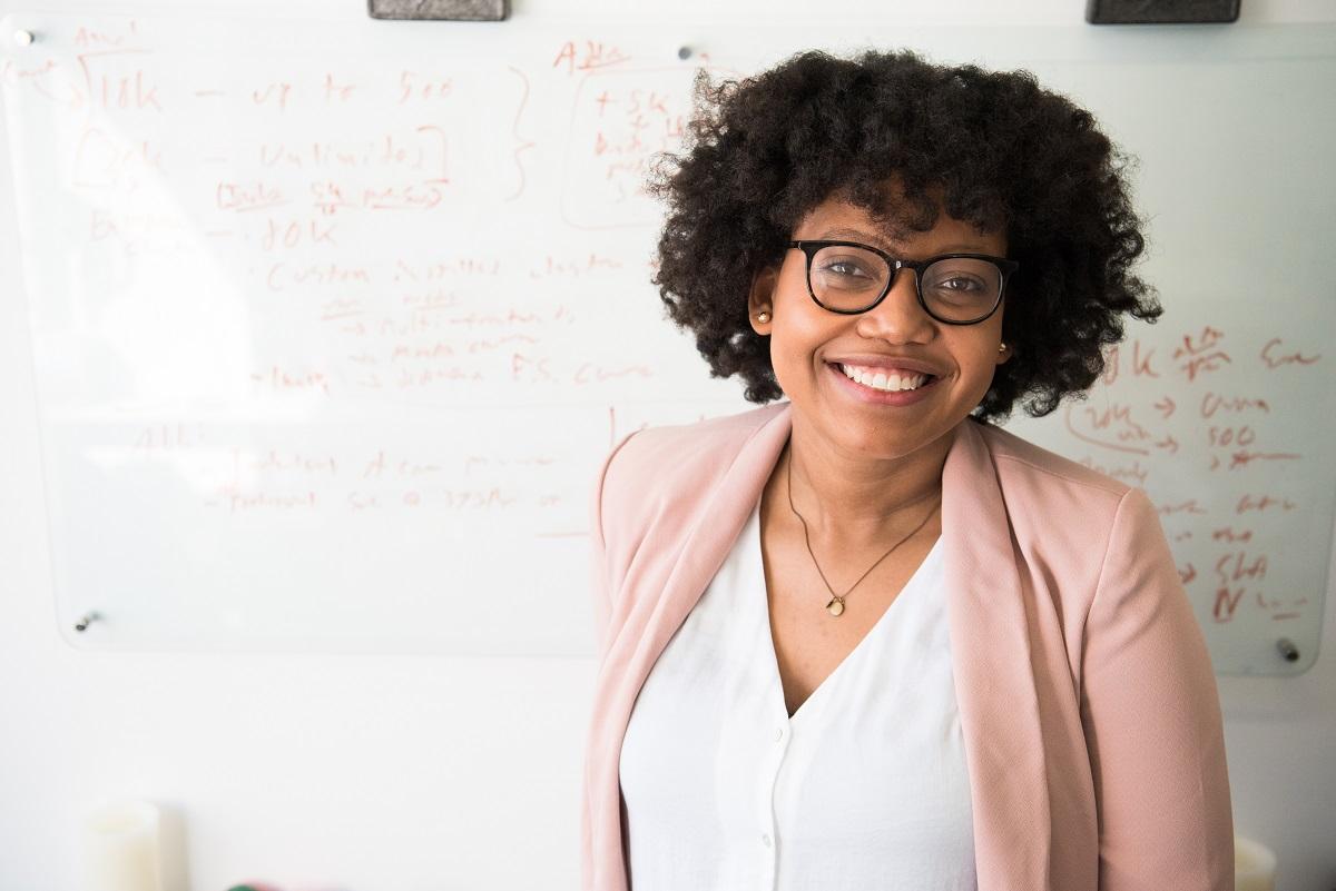 Teacher standing near whiteboard