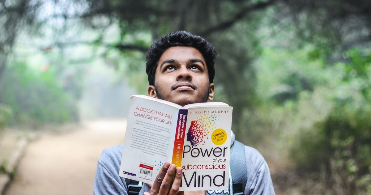 Student looks up while reading book