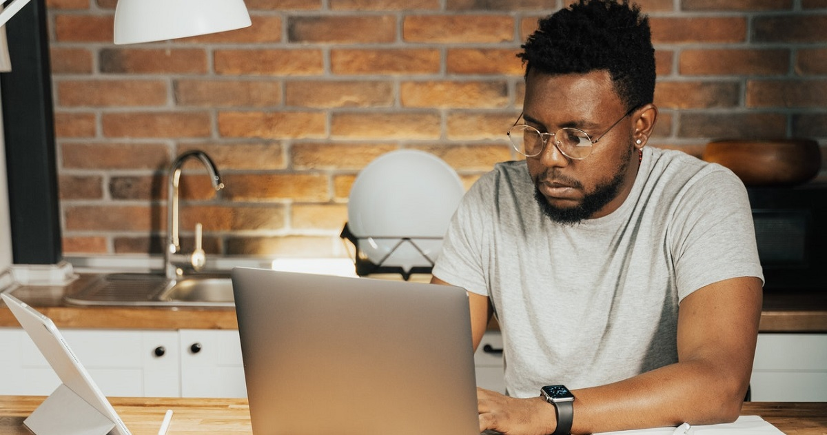 Guy studying on his laptop in office environment