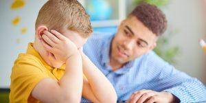 Man comforting a crying boy