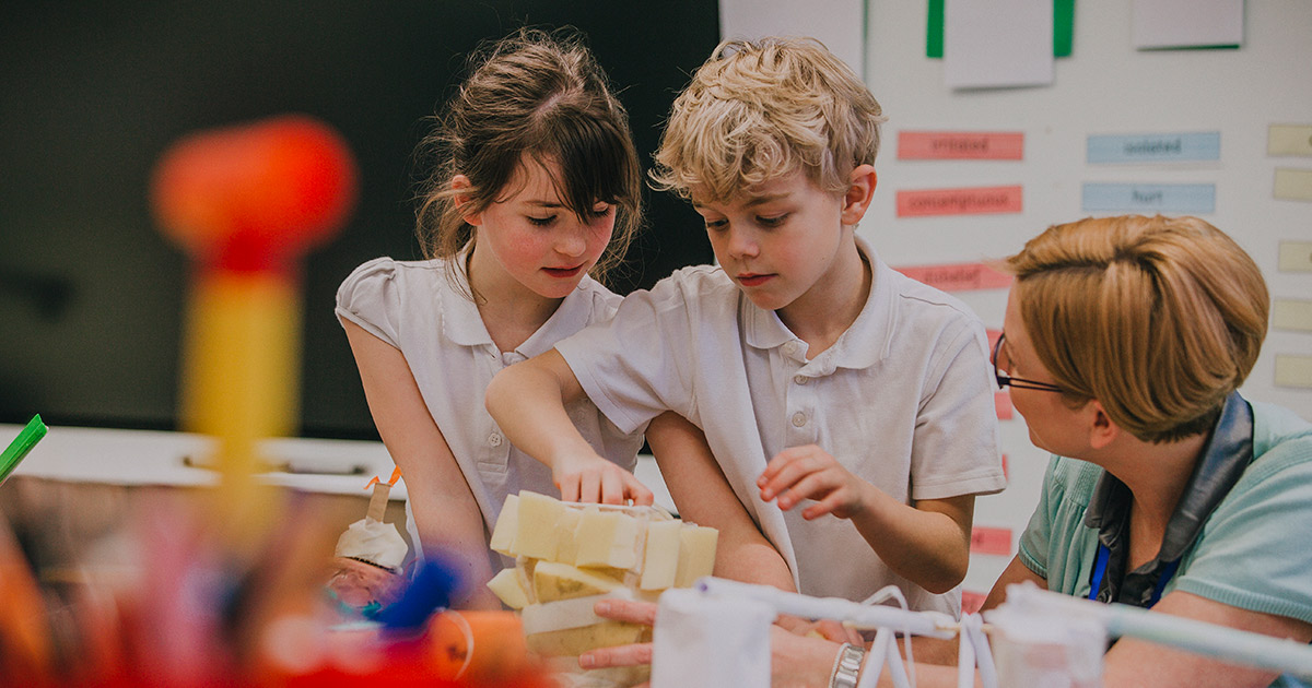 A teacher assisting her students with project-based learning