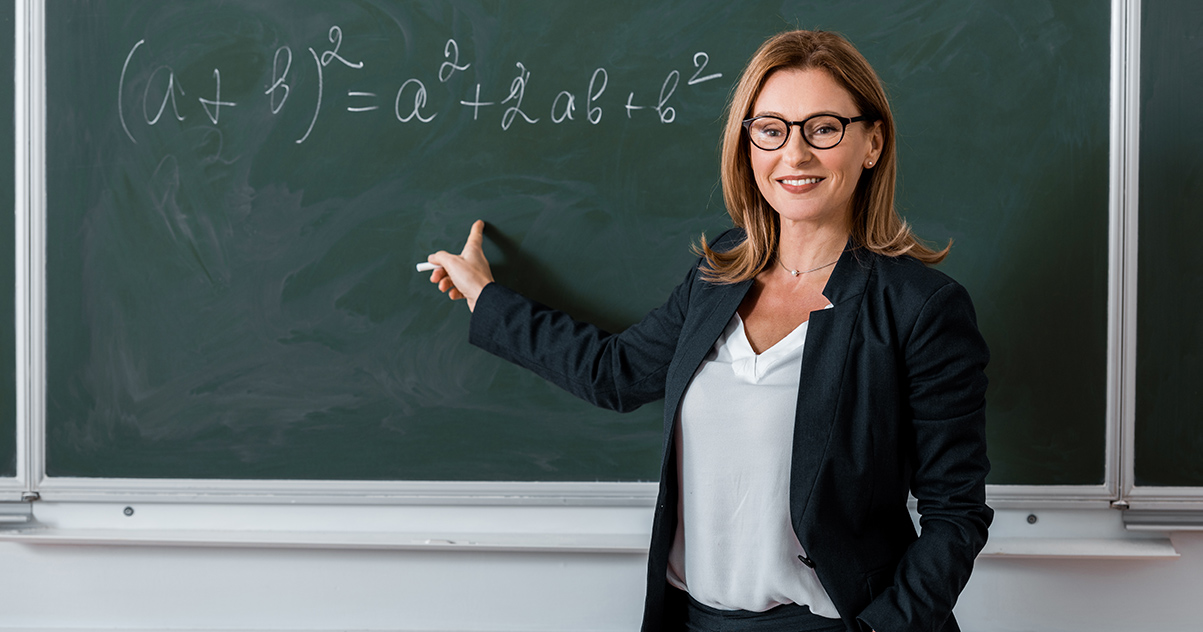 Teacher looking at chalkboard