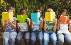 A group of children reading books