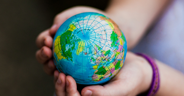 Girl holding miniature globe