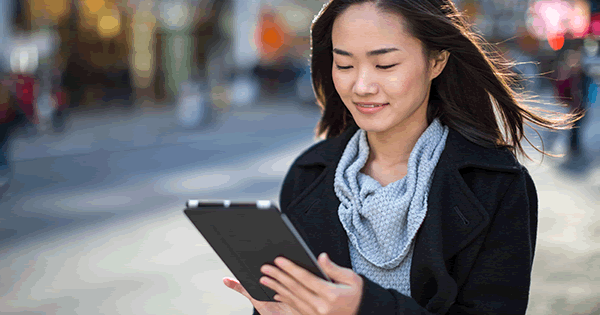 Woman holding a tablet outside on the go