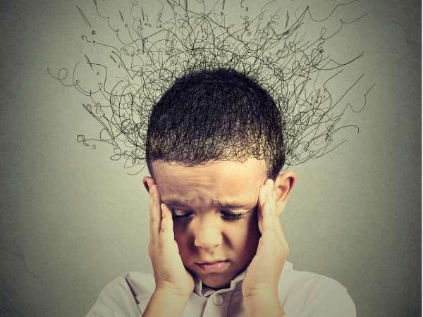 Boy frazzled with a headache