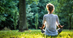 A teacher practicing self-care by meditating