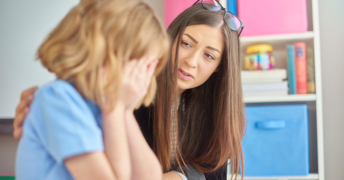A teacher comforting an upset student