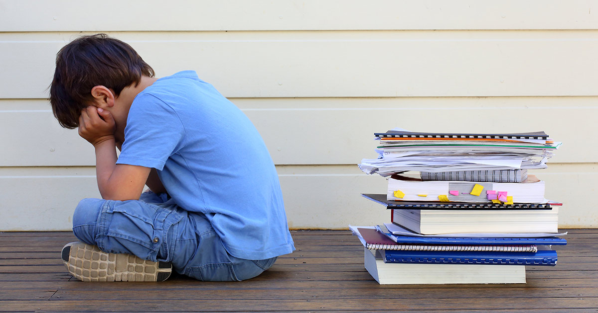 A child turning his back on books