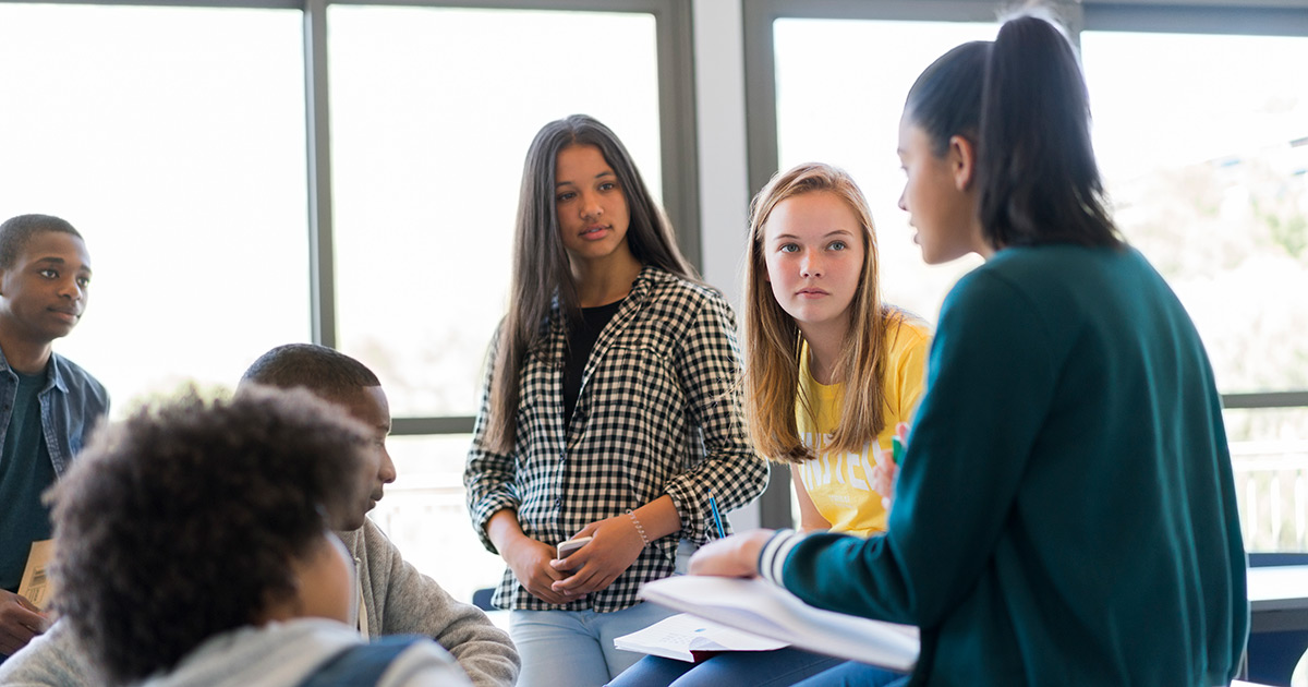 Students in a small-group discussion at the end of class
