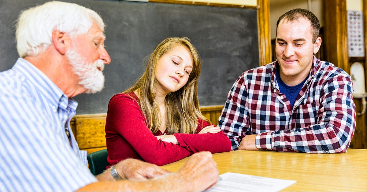A teacher leading a successful parent-teacher conference
