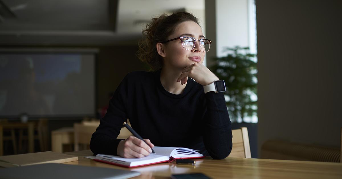 A teacher working on her mid-year checklist