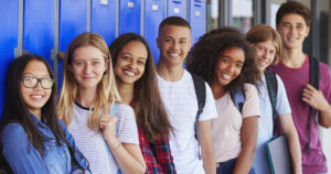 High school kids lined up along lockers