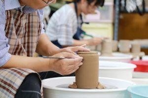 Ladies creating pottery
