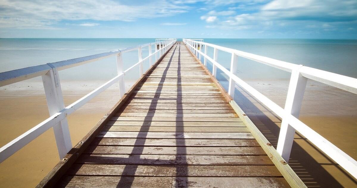 A long beach dock extending into the sea