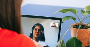 Two ladies talking on a video chat using a laptop