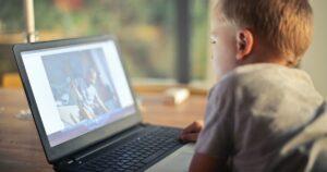Kid staring at laptop screen