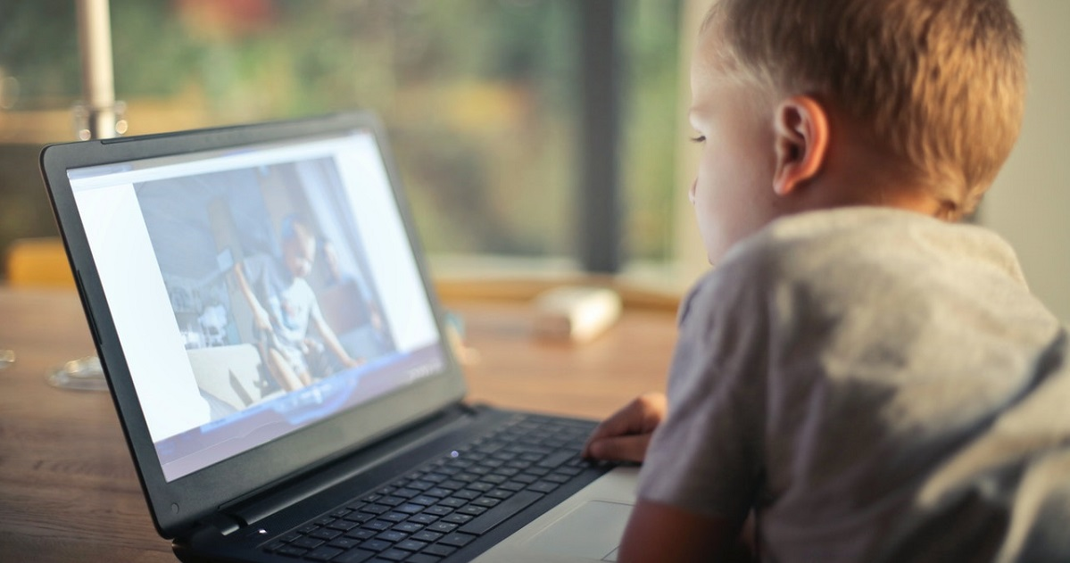 Kid staring at laptop screen