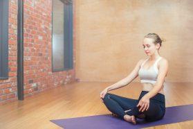 Woman meditating on mat